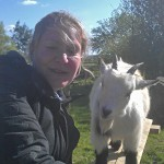 Elaine Symes, founder of Laineys Farm, with a goat